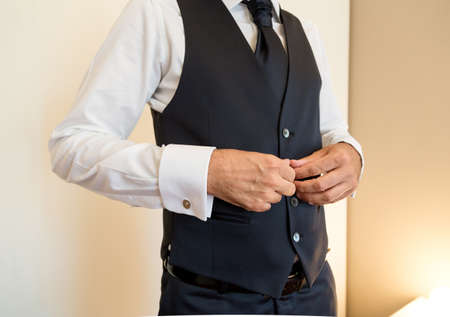 'getting ready': groom getting ready for a wedding day. Stock Photo