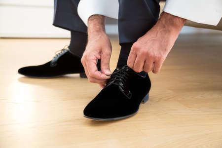 black shoes: groom in elegant black shoes