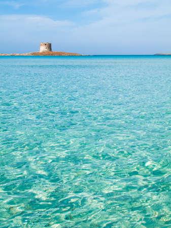 Amazing Pelosa beach, view of Pelosa Tower at Stintino, Sardinia italy