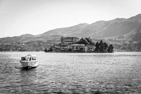orta: trip boat on San Giulio island at Lake Orta, Piedmont, Italy Stock Photo