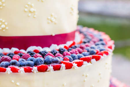 sweet wedding cake with fresh berries