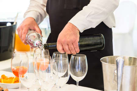 waiter serving champagne Stock Photo