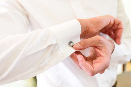 The man in the white shirt and cufflinks. Stock Photo