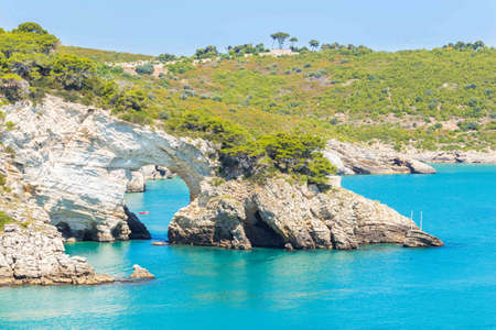 Scenic view of San Felice bay with is natural arch (Architello) on Gargano coast, Apulia, Italy.
