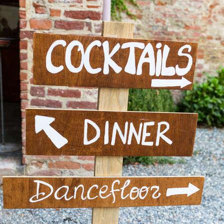 wooden sign indicates wedding reception