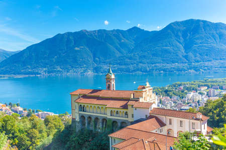 View of Madonna del Sasso Church above Locarno city and the Maggiore lake in Ticino, Switzerland