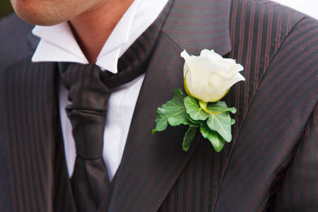 Groom in elegant tuxedo with boutonniere
