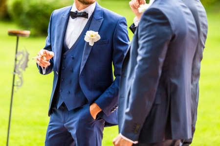 the groom speaks with his wedding witness Banco de Imagens