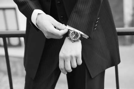 mans hands with wristwatch