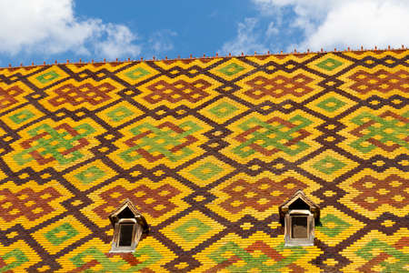 19 September 2019. Detail of the colored roof of the of Hotel Dieu or Hospice de Beaune, in Burgundy region, France 報道画像