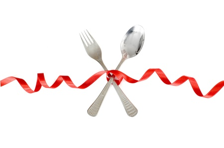 Spoon and fork tied with a  red ribbon photo