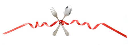 Spoon and fork tied with a long red ribbon