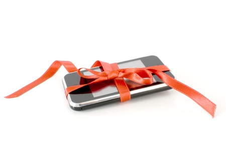 Modern mobile phone with a red ribbon photo