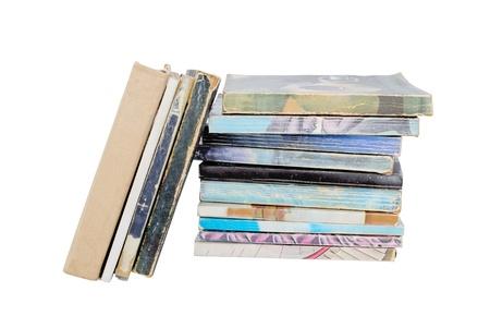 Piled vintage worn out books Standard-Bild