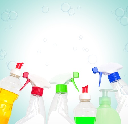 Cleaning products in different colors on bubbles background photo
