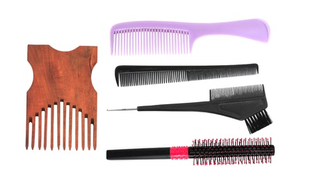 Different hair combs on white background photo