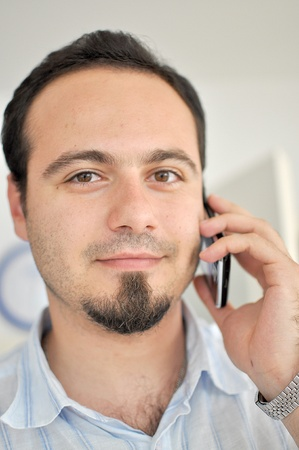 Young man talking on the phone Stock Photo - 12131419
