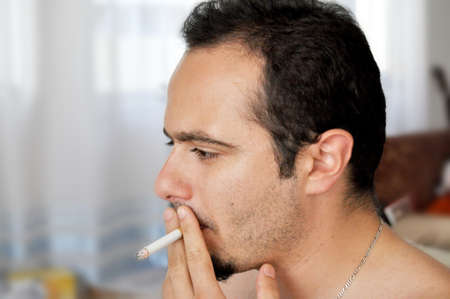 Young man smoking a cigarette Stock Photo - 12355605