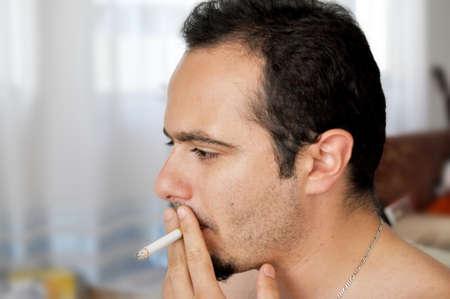 Young man smoking a cigarette Stock Photo - 12355605