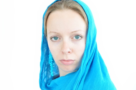 woman with turquoise earrings and scarf photo