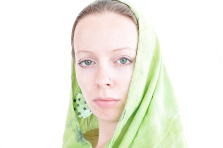 young woman with green scarf and green earrings photo