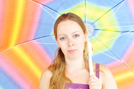 young fresh woman, holding sun umbrella photo