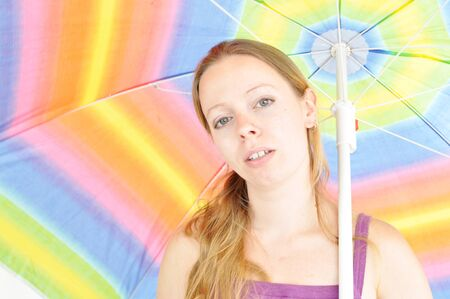 young woman holding summer umbrella photo
