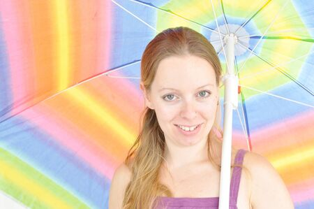 young woman holding summer umbrella photo