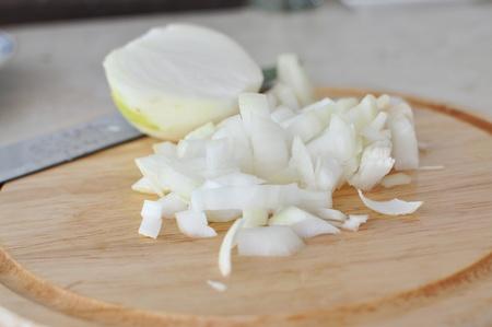 chopped onion on wooden chopping board