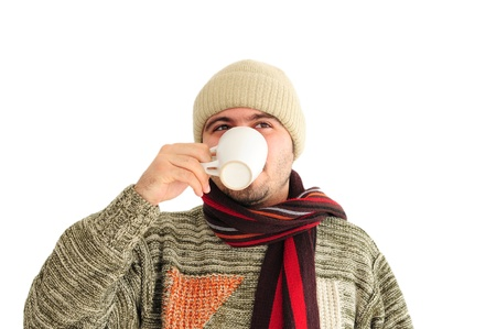Young man enjoying cup of teacoffee photo