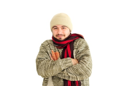Young man in winter clothes getting cold photo