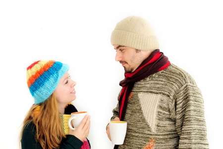 Young couple enjoying a cup of tea/coffee  Stock Photo - 12131308