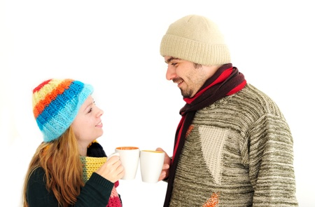 Young couple enjoying a cup of tea/coffee  Stock Photo - 12131277