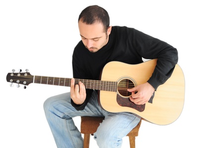Young caucasian man playing the guitar