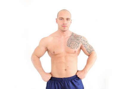 young muscular man with tatoo on the chest Stock Photo