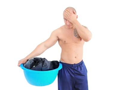 young muscular man with laundry basket