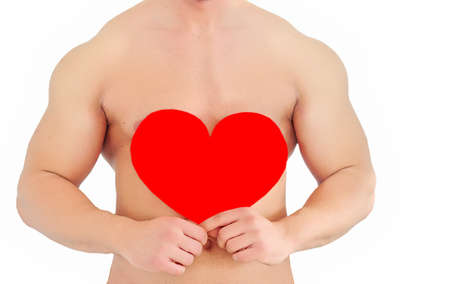 Young topless man holding red heart