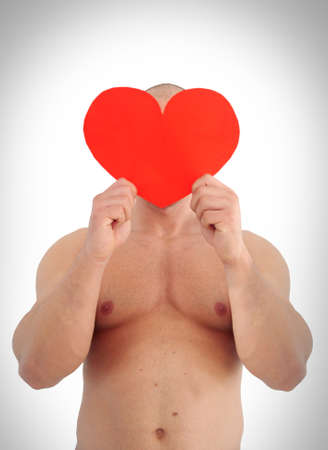 young muscular caucasian man holding heart on his face Stock Photo - 12131141
