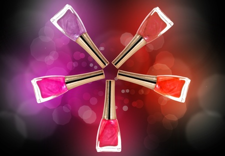 five colors of nail polish - red, purple, pink, raspberry, dark red over dark background photo