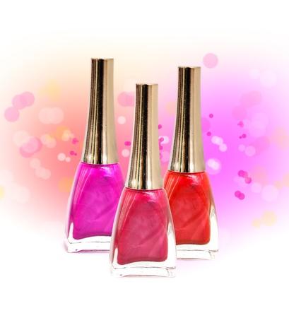 nail polish bottle: Set of three nail polish bottles - red, pink, purple Stock Photo