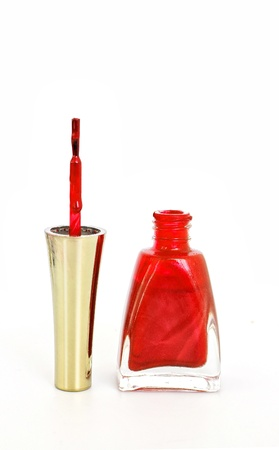 Opened bottle of red nail polish with brush photo