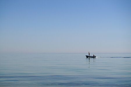 Two men in a fishing motor boat in the sea photo