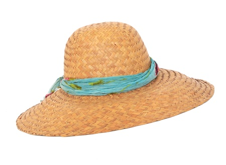 Panama summer wicker hat with blue ribbon on white background