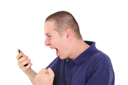 Angry young man shouting on the phone photo