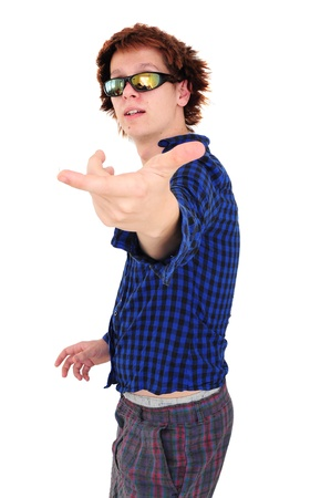 Young goofy man with funny clothes and hair pointing at camera, pretending to be teen superstar Stock Photo