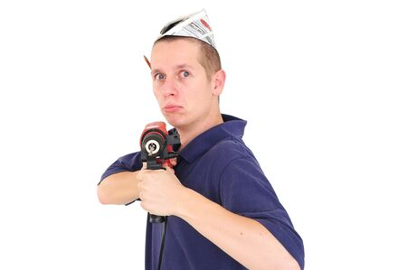 Young serious man with drill and paper hat aiming at camera Stock Photo - 12131042