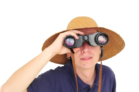 Young caucasian man with straw hat and binoculars photo