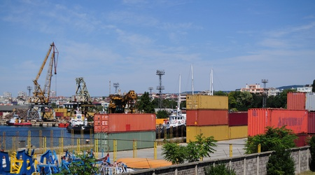Containers and cranes in harbour yard