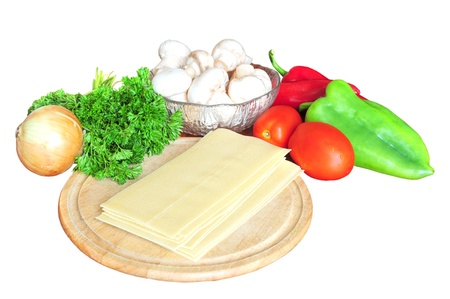 Ingredients for lasagna - tomatoes, peppers, onion, parsley, mushrooms, pasta, isolated on white Stock Photo - 12131199