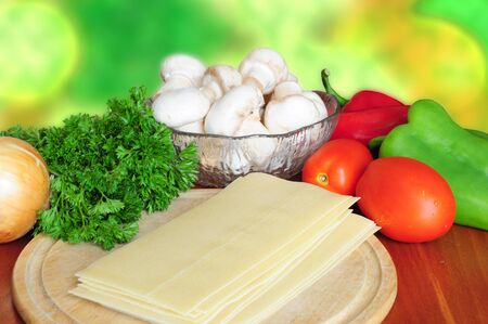 Ingredients for lasagna - tomatoes, pepper, parsley, mushrooms, onion, pasta Stock Photo - 12131282